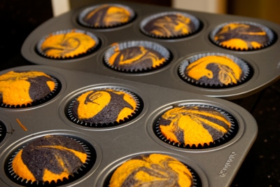 Ghoulishly Orange and Black Halloween Cupcakes on https://www.theculinarylife.com/